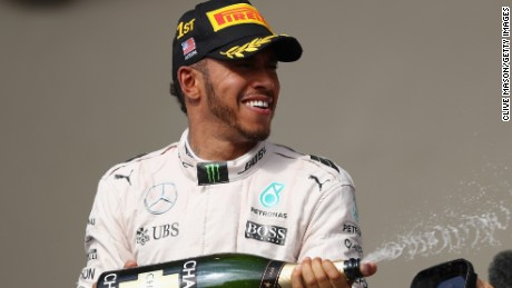 Lewis Hamilton has that champagne moment after claiming his seventh victory of the season and his 50th GP win.