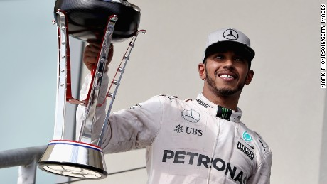 Lewis Hamilton lifts the trophy after a superb victory at the Circuit of The Americas.