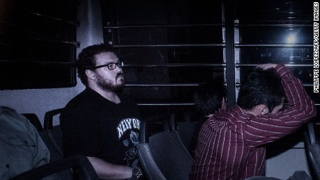 British banker Rurik Jutting (L), charged with the grisly murders of two women, sits in a prison van as he arrives at the eastern court in Hong Kong on November 24, 2014. Jutting was back in court for a pre-trial hearing after he was charged with the grisly murder of two young women. AFP PHOTO / Philippe Lopez        (Photo credit should read PHILIPPE LOPEZ/AFP/Getty Images)