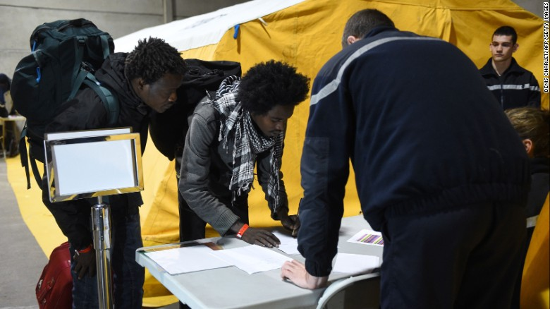 Migrants on Monday registered to claim asylum in France and be settled in different regions.