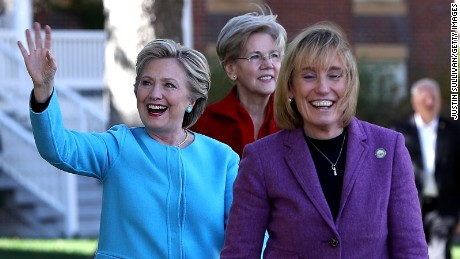 (L-R)  Democratic presidential nominee former Secretary of State Hillary Clinton, U.S. Sen Elizabeth Warren (D-MA) and New Hampshire Gov. Maggie Hassan greet supporters during a campaign rally at Saint Anselm College on October 24, 2016 in Manchester, New Hampshire.