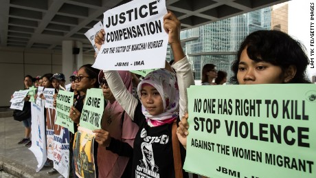 HONG KONG - OCTOBER 24:  Members of Asian Migrants Coordinating Body (AMCB) protest outside the High Court on October 24, 2016 in Hong Kong, Hong Kong. Rurik Jutting, a former banker with Bank of America Merrill Lynch, stands accused of  murdering two Indonesian women whose bodies were found mutilated in his upscale apartment flat in November 2014 in the Wan Chai district of Hong Kong, according to published reports.  (Photo by Lam Yik Fei/Getty Images)