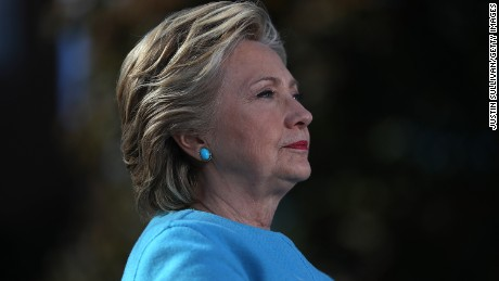 Democratic presidential nominee former Secretary of State Hillary Clinton looks on during a campaign rally at Saint Anselm College on October 24, 2016 in Manchester, New Hampshire.