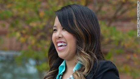 Patient Nina Pham smiles as she speaks outside of National Institutes of Health (NIH) in Bethesda, Md., Friday, Oct. 24, 2014. Pham, the first nurse diagnosed with Ebola after treating an infected man at a Dallas hospital is free of the virus. The 26-year-old Pham arrived last week at the NIH Clinical Center. She had been flown there from Texas Health Presbyterian Hospital Dallas. (AP Photo/Pablo Martinez Monsivais)