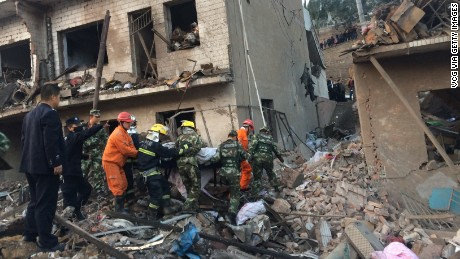 Rescuers work at the site of an explosion in Xinmin, Fugu County, China.