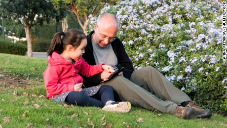 Autistic girl and tutor on therapy in the park