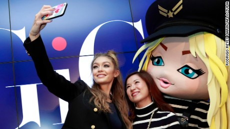 American fashion model and TV personality Gigi Hadid takes a selfie with fan during a special event to celebrate the launch of her collaboration with Tommy Hilfiger TOMMYxGIGI at the brand's Omotesando store on October 12, 2016, Tokyo, Japan. Hadid took selfies with fans and Japanese celebrities during the event for the brand's Fall Winter 2016 collection in Tokyo. This is Hadid's first visit to Japan. (Credit Image: © Rodrigo Reyes Marin/AFLO via ZUMA Press)
