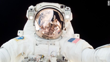 Astronaut Scott Parazynski participates in the third scheduled session of extravehicular activity as construction continues on the International Space Station. During the 7-hour, 8-minute spacewalk Parazynski and astronaut Doug Wheelock (out of frame), installed the P6 truss segment with its set of solar arrays to its permanent home, installed a spare main bus switching unit on a stowage platform, and performed a few get-ahead tasks.