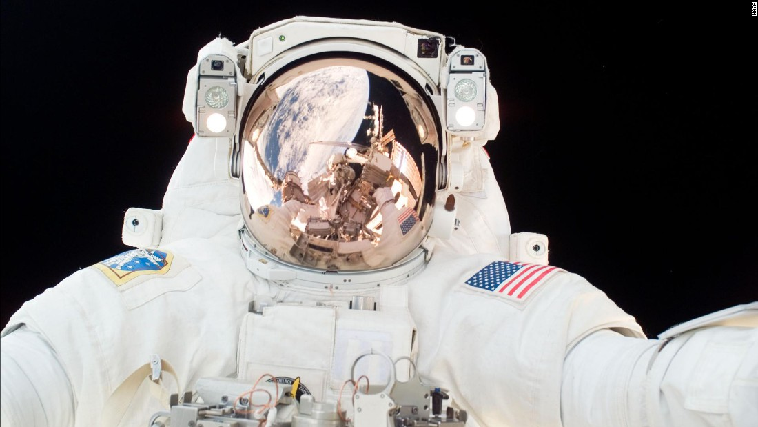 an astronaut goes out for a space walk - photo #11