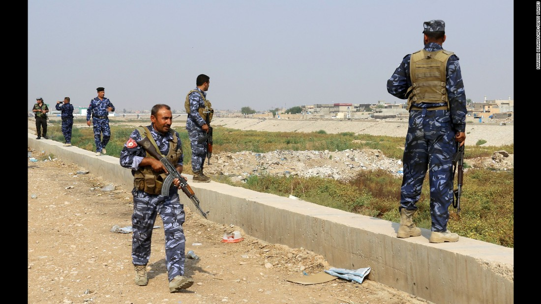 Iraqi forces patrol an area of Kirkuk, Iraq, as they look for members of ISIS on Tuesday, October 25. An Iraqi-led offensive is underway to reclaim the largest region of Iraq under ISIS control.
