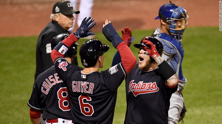 Roberto Perez of the Cleveland Indians celebrates with Lonnie Chisenhall and Brandon Guyer after hitting a three-run home run during the eighth inning putting Cleveland up 6 - 0. The Cleveland Indians won the first game of the series.
