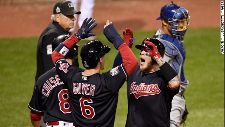 Roberto Perez of the Cleveland Indians celebrates with Lonnie Chisenhall and Brandon Guyer after hitting a three-run home run during the eighth inning against the Chicago Cubs in Game One of the 2016 World Series at Progressive Field on October 25, 2016 in Cleveland, Ohio.