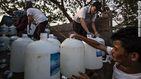 Volunteers prepare the clean water donation service on May 1, 2016 in Dala, Burma.