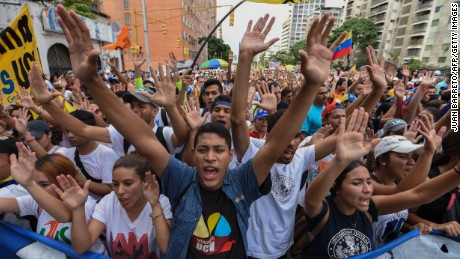"University students march against the government of Venezuelan President Nicolas Maduro in the streets of Caracas on October 26, 2016.  Venezuela's political rivals are set to engage in a volatile test of strength on Wednesday, with the opposition vowing mass street protests as President Nicolas Maduro resists efforts to drive him from power. The socialist president and center-right-dominated opposition accuse each other of mounting a ""coup"" in a volatile country rich in oil but short of food."