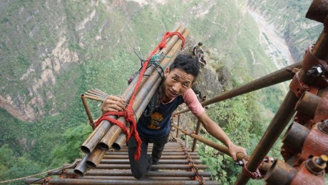 A mountain village on a cliff in southwestern China has been building a huge steel ladder to connect it to the outside world more securely, using more than 1,500 steel pipes. The village started to construct the ladder in August 2016 with an investment of 1 million yuan ($147,928) from local authorities. Situated at the top of a mountain in Liangshan Yi Autonomous Prefecture, Sichuan province, the isolated village of Atulieer is perched nearly 1,000 meters above the valley floor and villagers need to climb 17 rattan ladders to reach their homes. The construction would require more than 1,500 steel pipes with a diameter of 5cm as guardrails and steps, a village official was quoted as saying.    Photo by Imaginechina