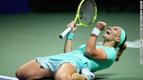 Svetlana Kuznetsova celebrates after beating Karolina Pliskova in three sets in Singapore.