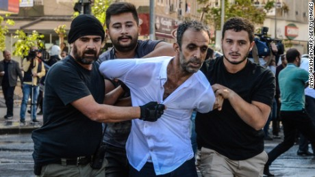 Turkish plain-clothes police officers detain a protester on October 26, during a demonstration against the detention of the Kurdish-majority city's co-mayors in Diyarbakir. Gultan Kisanak and Firat Anli were taken into custody on October 25, at night in a surprise move against the leaders of a city hit by renewed fighting between Turkish forces and members of the outlawed Kurdistan Workers' Party.