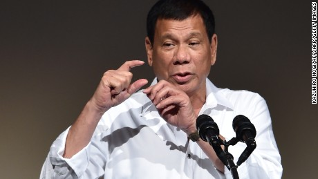 "Philippines' President Rodrigo Duterte delivers a speech at the Philippines' Economic Forum in Tokyo on October 26, 2016.  Duterte was set on October 26 to persuade Japanese executives his country is ""open for business"", after upending traditional alliances by insulting the US and making overtures to China. / AFP / KAZUHIRO NOGI        (Photo credit should read KAZUHIRO NOGI/AFP/Getty Images)"