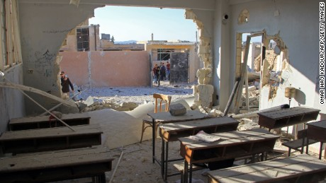 A general view shows a damaged classroom at a school after it was hit in an air strike in the village of Hass, in the south of Syria's rebel-held Idlib province on October 26, 2016. / AFP / Omar haj kadour        (Photo credit should read OMAR HAJ KADOUR/AFP/Getty Images)
