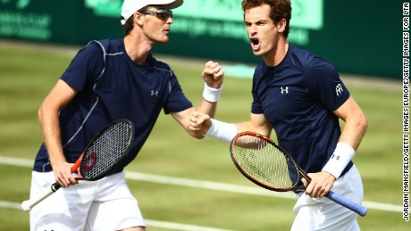 LONDON, ENGLAND - JULY 18:  Andy Murray of Great Britain celebrates winning second set tie break with Jamie Murray of Great Britian against Nicolas Mahut and Jo-Wilfried Tsonga of France in the doubles match during Day Two of the World Group Quarter Final Davis Cup match between Great Britain and France at Queens Club on July 18, 2015 in London, England.  (Photo by Jordan Mansfield/Getty Images for LTA)