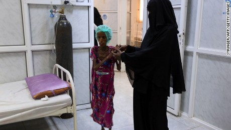 Saida Ahmad Baghili, an 18-year-old Yemeni woman from an impoverished coastal village on the outskirts of the rebel-held Yemeni port city of Hodeida where malnutrition has hit the population hard, is assisted as she walks at the al-Thawra hospital in Hodeidah where she is receiving treatment for severe malnutrition on October 25, 2016. The UN's children agency UNICEF estimates that three million people are in need of immediate food supplies in Yemen, while 1.5 million children suffer from malnutrition.  / AFP PHOTO / STRINGERSTRINGER/AFP/Getty Images