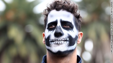 MEXICO CITY, MEXICO - OCTOBER 27:  Daniel Ricciardo of Australia and Red Bull Racing walks in the Paddock with full Dia de Muertos face paint during previews to the Formula One Grand Prix of Mexico at Autodromo Hermanos Rodriguez on October 27, 2016 in Mexico City, Mexico.  (Photo by Lars Baron/Getty Images)