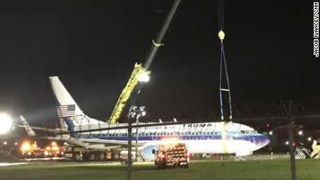 Emergency crews are working to remove the plane Republican vice presidential nominee Mike Pence was riding in as it skidded off the runway Thursday night at LaGuardia Airport in New York.