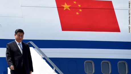 Chinese President, Xi Jinping gestures on his arrival at the airport in Goa on October 15, 2016. Indian Prime Minister Narendra Modi will hold talks with China's President Xi Jinping late October 15, in the hope of boosting investment and trade, but with relations frustrated by Beijing's decision so far to block New Delhi's entry to a nuclear trade group, among other issues. / AFP / MONEY SHARMA        (Photo credit should read MONEY SHARMA/AFP/Getty Images)