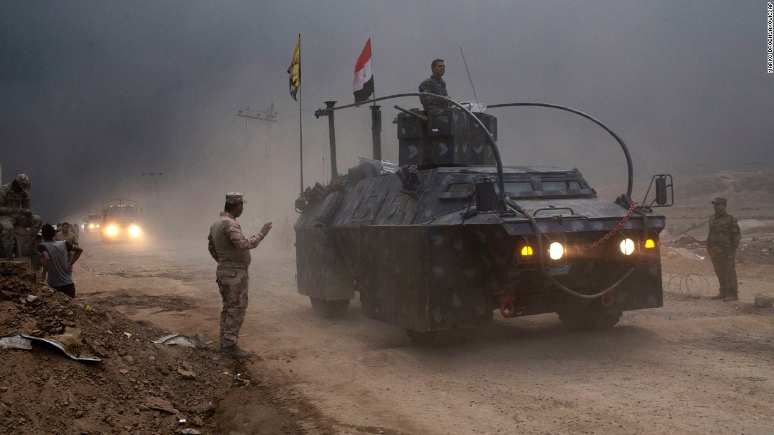 An Iraqi federal police vehicle clears a checkpoint in Qayyara on October 26.