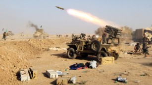 Shiite fighters from the Hashed al-Shaabi launch missiles on the village of Salmani, south of Mosul, on Sunday, October 30. An Iraqi-led offensive is underway to reclaim Mosul, Iraq's second-largest city and the last major stronghold for ISIS in the country.