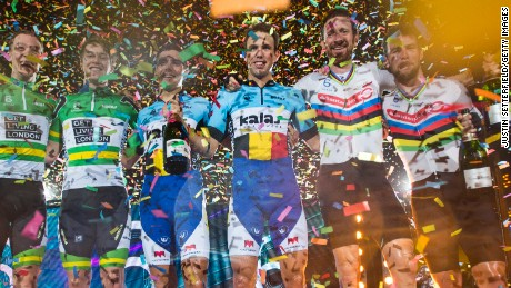 Kenny de Ketele and Moreno de Pauw of Belgium share the podium with Bradley Wiggins and Mark Cavendish and the Australian pair of Cameron Meyer and Callum Scotson.