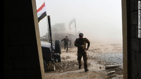 TOPSHOT - Members of the Iraqi Counter Terrorism Service (CTS) take shelter after a mortar shell hit nearby near the village of Bazwaya, on the eastern edges of Mosul, as they advance towards Iraq's last remaining   http://Liv-Aguilera.easyxblogs.com - http://Liv-Aguilera.easyxblogs.com  -  Islamic State (IS) group stronghold on October 31, 2016. An Iraqi colonel said CTS had recaptured Bazwaya, one of two IS-held villages that had been standing between Iraqi forces and the eastern edges of Mosul. / AFP / BULENT KILIC        (Photo credit should read BULENT KILIC/AFP/Getty Images)