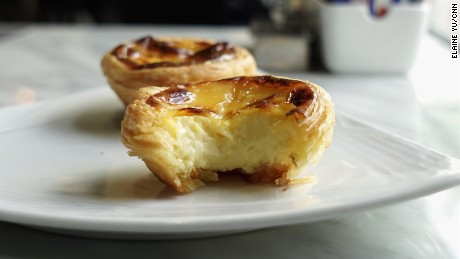 Batches of Lord Stow's Bakery egg tarts are freshly baked and available for take-out.