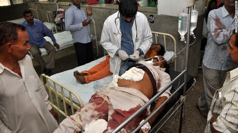 An Indian victim of cross-border shelling is treated in a hospital in Jammu Tuesday.