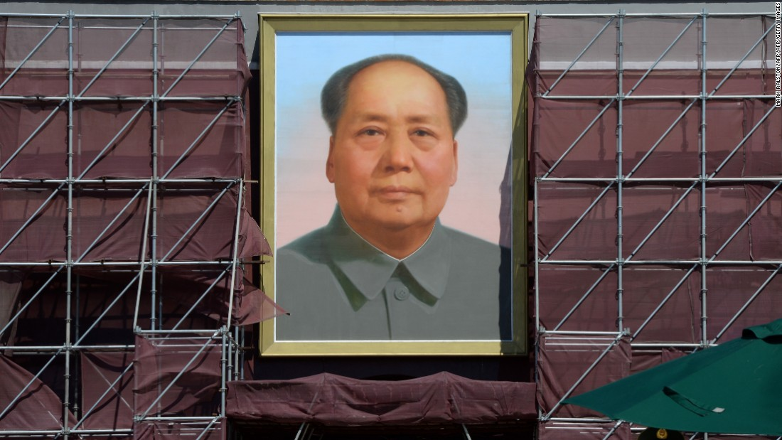 Xi praises free trade, Mao critics lose jobs