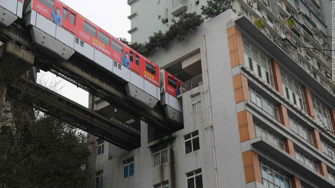 China builds train line straight through apartment building