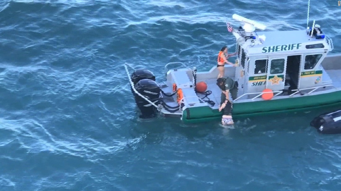 Jet skiers saved from path of cruise ship
