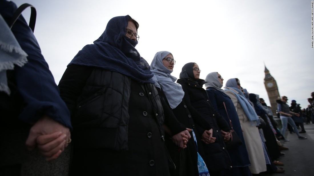 Muslim women stand with terror victims