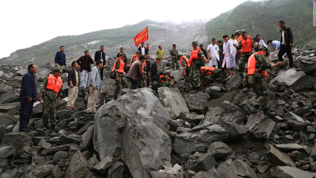 At least 15 dead, 118 missing after China landslide