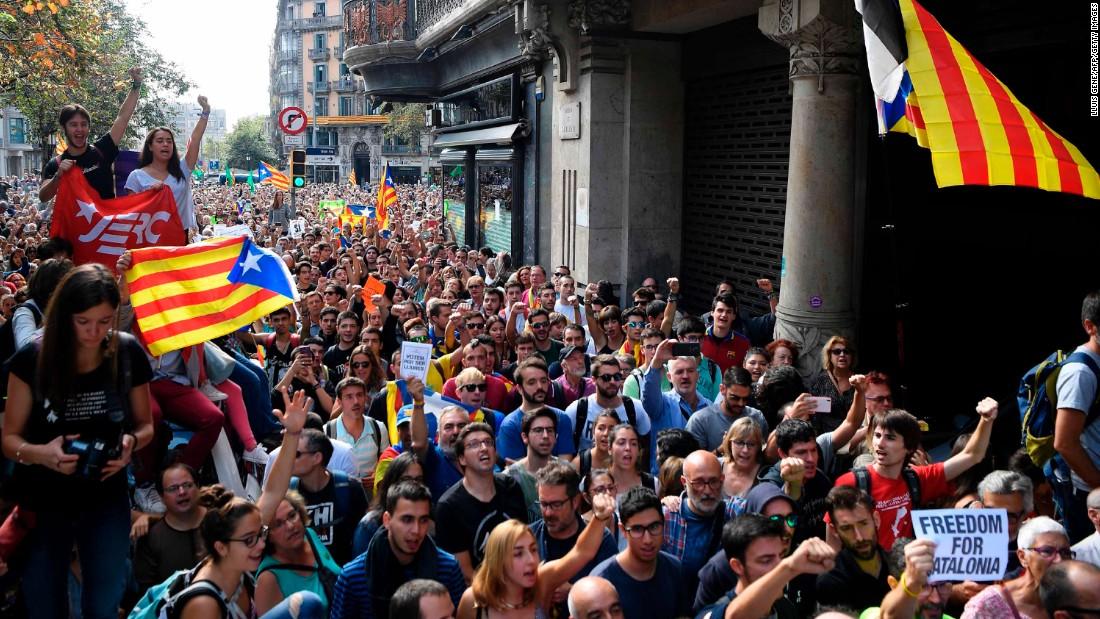 Catalan President blasts Madrid for 'illegal' referendum raids
