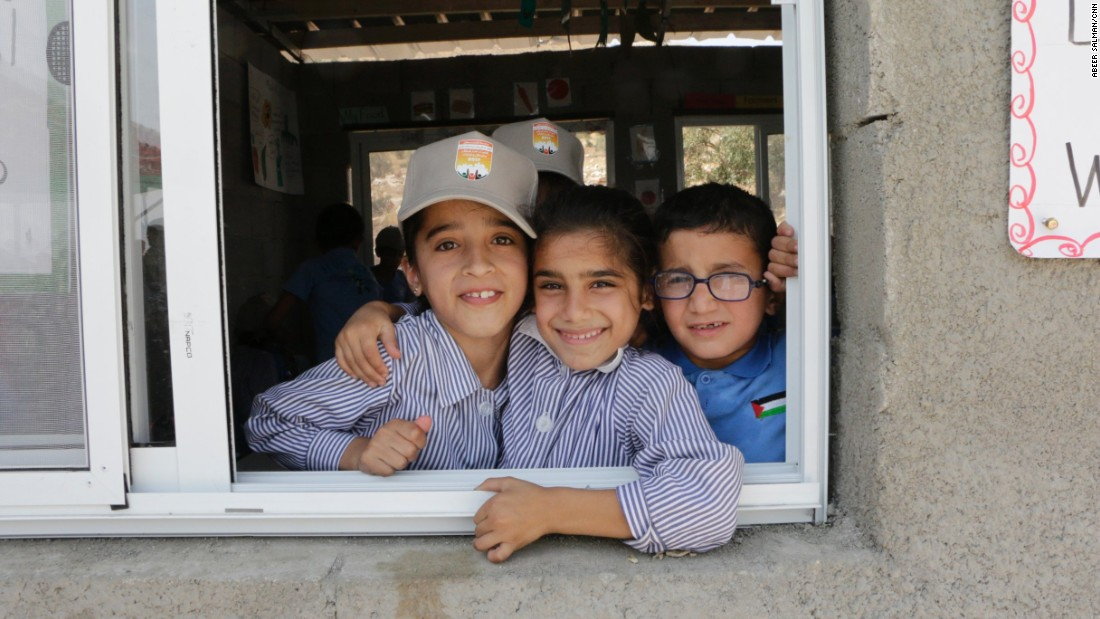 Palestinians rebuild school toppled by Israel