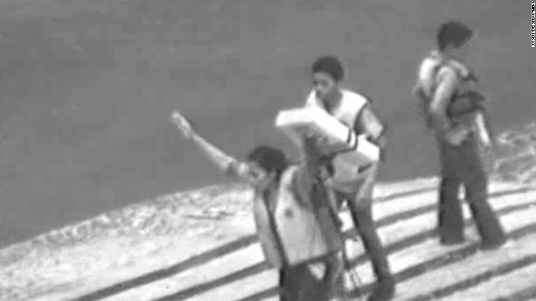 Mom and kids stranded on capsized boat