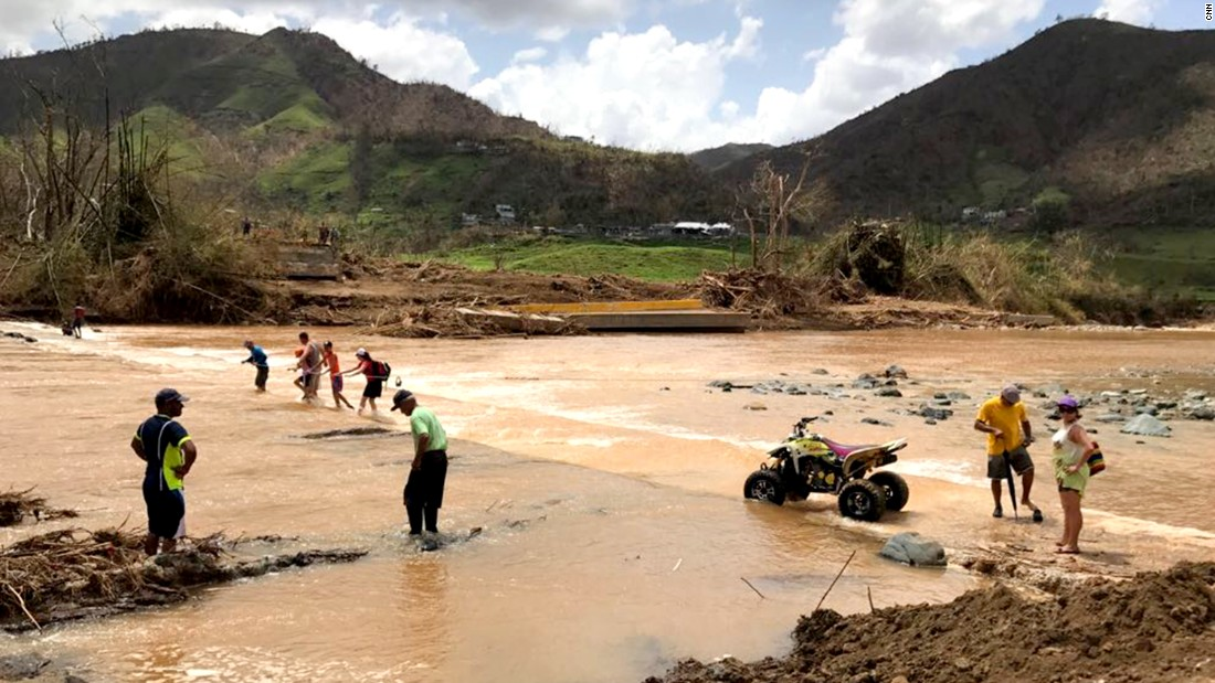 Cut off after bridge collapsed, Puerto Ricans cross river with cable