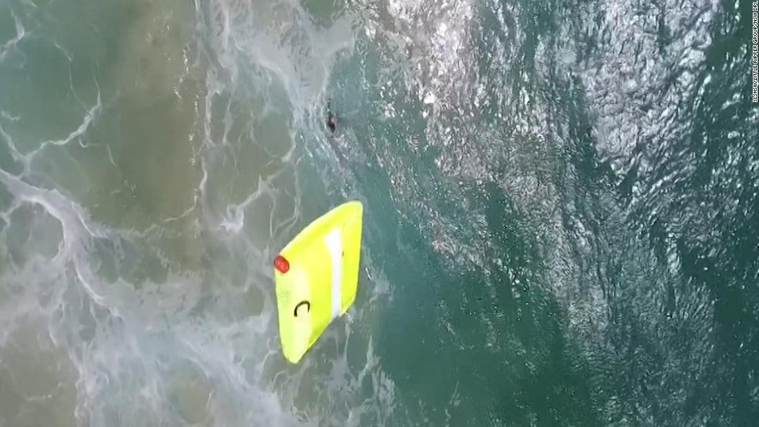 Drone spots swimmers, then does this