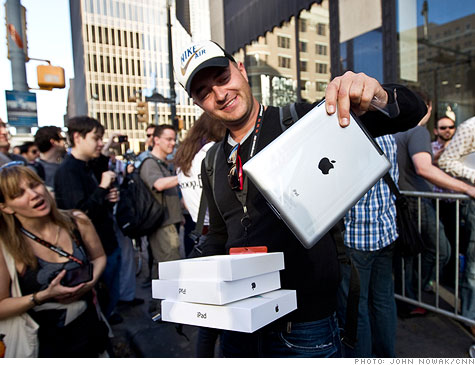 Apple's thinner and faster iPad 2 drew giant crowds on its launch day.