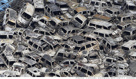 Expect car prices to rise as the effects of Japan's earthquake and violence in Libya begin to be felt. In this image, cars that had been ready for export are piled up in a Japanese port.