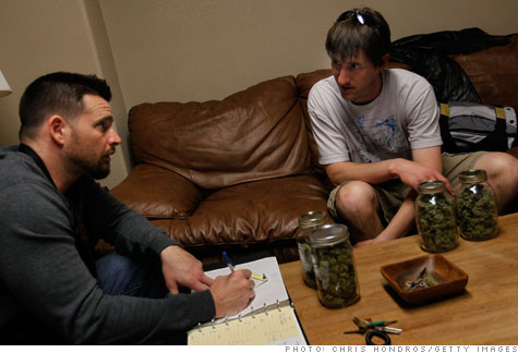 Abundant Healing co-owner Drew Brown meets with one of his store's marijuana suppliers.
