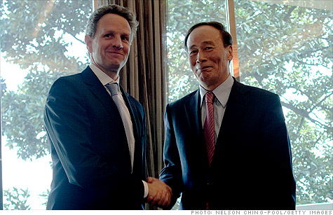 U.S. Treasury Secretary Tim Geithner shakes hands with Wang Qishan, China's vice premier during the G20 seminar in Nanjing, China.