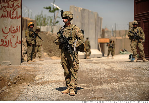 U.S. soldiers stand guard before the opening ceremony for a newly completed mosque in a village in southern Kandahar province, Afghanistan.