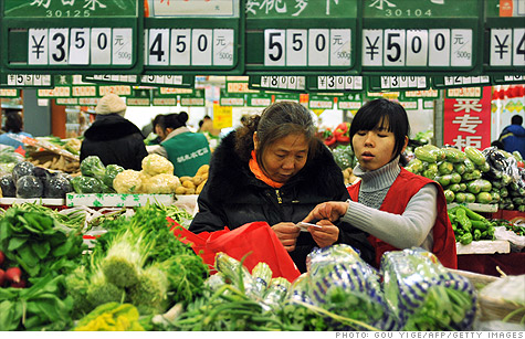 China's economy grew at a slightly slower rate in the first quarter, as food prices continued to surge and limit the purchasing power of consumers.